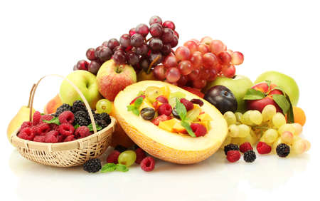 fresh fruits salad in melon, fruits and berries, isolated on white photo
