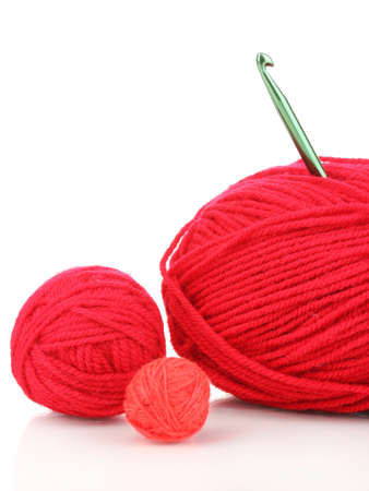 Red knittings yarns isolated on white photo