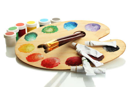 wooden art palette with paint and brushes isolated on white Stock Photo - 14759548