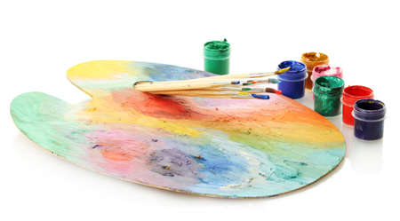 wooden art palette with paint and brushes isolated on white Stock Photo - 14759343