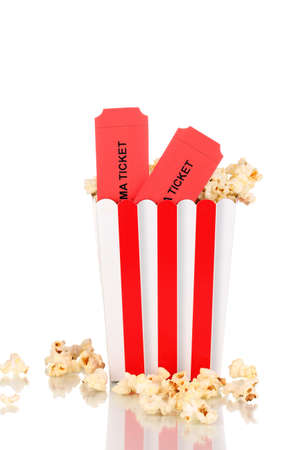 classic box of popcorn and cinema tickets isolated on white photo