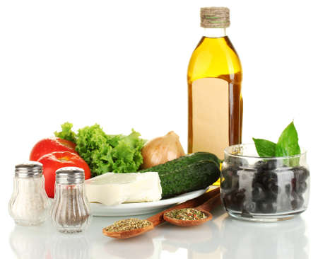 Ingredients for a Greek salad isolated on white background photo