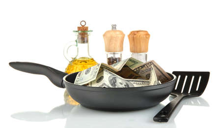 Banknotes in a frying pan with cooking spatula isolated on white Stock Photo - 14763578