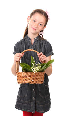 Portrait of beautiful little girl with lilies of the valley in basket isolated on white photo