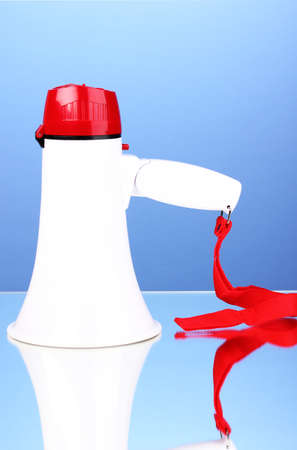red and white megaphone on blue background photo
