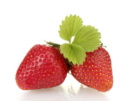 strawberries: sweet ripe strawberries with leaves isolated on white