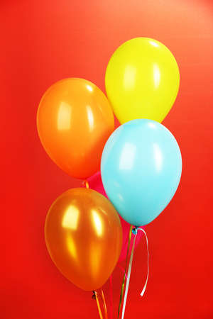 colorful balloons on red background photo