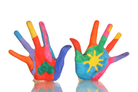 brightly colored: Brightly colored hands on white background close-up
