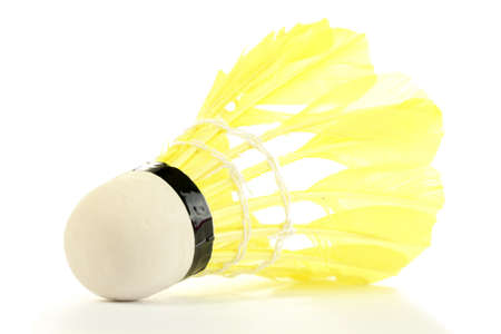 yellow feather shuttlecock isolated on white photo