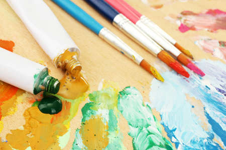 Abstract acrylic paint, paint tubes and brushes on wooden  palette Stock Photo - 14775670