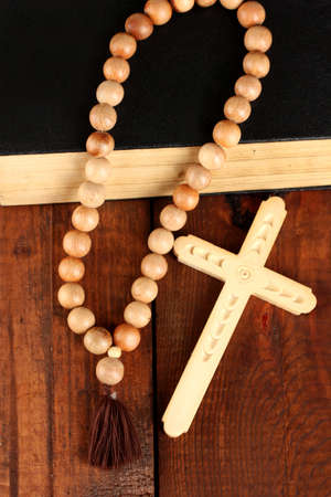 the Wooden rosary beads and holy bible close-up photo