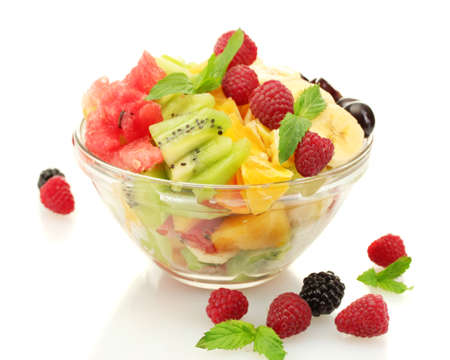 fruit mix: fresh fruits salad in bowl  and berries, isolated on white