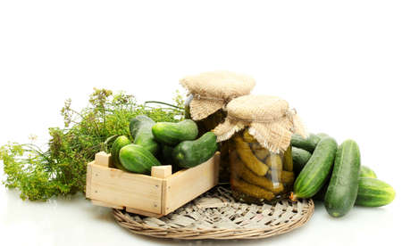 fresh cucumbers in wooden box, pickles and dill isolated on white photo