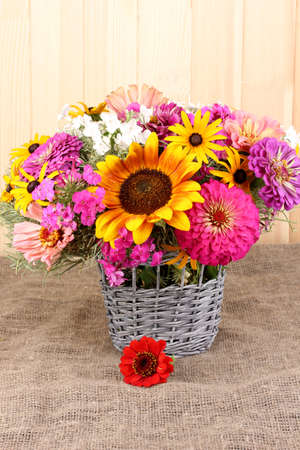 ronantic: Beautiful bouquet of bright flowers on sacking on wooden background