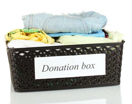 Donation box with clothing isolated on white Stock Photo - 14775425
