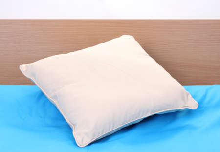 pillow on bed on white background photo