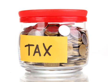 tax tips: Glass bank for tips with money isolated on white