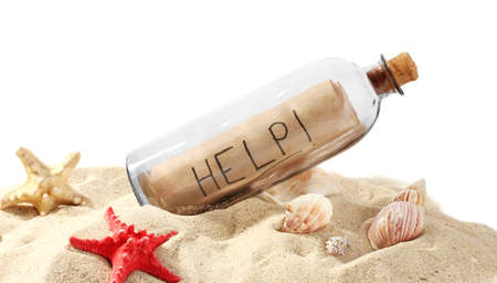 Glass bottle with note inside on sand isolated on white Stock Photo