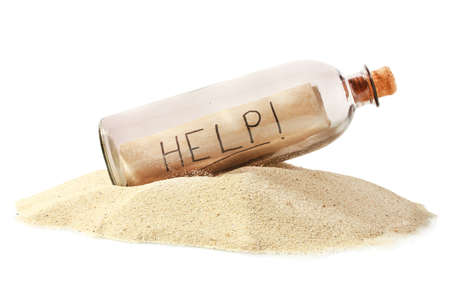 Glass bottle with note inside on sand isolated on white Stock Photo - 14822749
