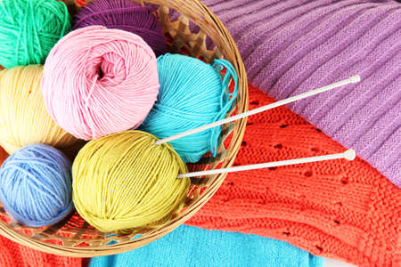 colorful wool sweaters and balls of wool close-up Stock Photo