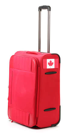 red suitcase with sticker with flag of Canada isolated on white Stock Photo - 14822680