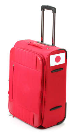 red suitcase with sticker with flag of Japan isolated on white Stock Photo - 14822701