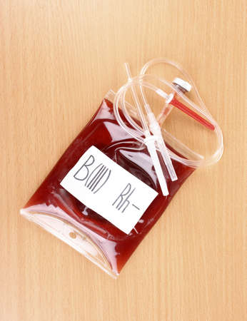 Bag of blood and infusion on wooden background photo