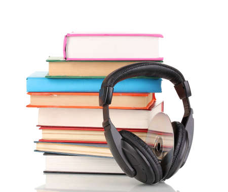Headphones on books isolated on white photo