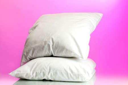 pillows, on pink background photo