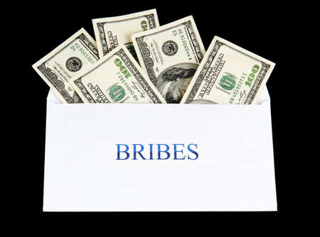 bribes: The envelope with the money bills isolated on black. Bribes.