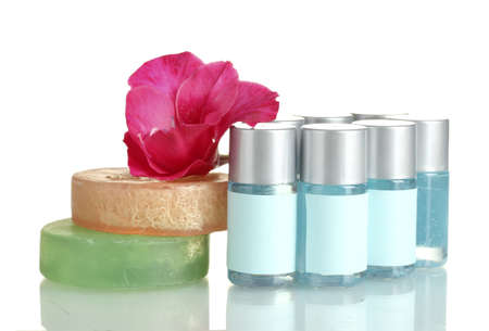 cosmetic bottles, soap and flower, isolated on white  Stock Photo - 15196272