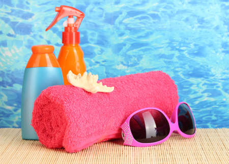 bright beach accessories, on blue sea background Stock Photo - 15198805