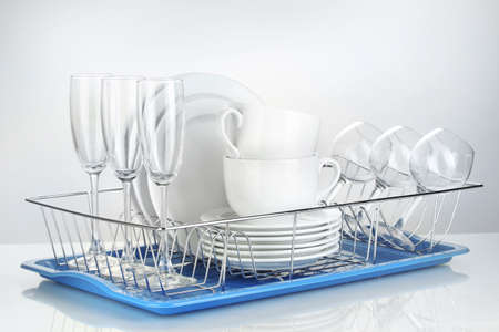 clean dishes on stand isolated on white photo