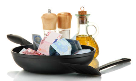 Banknotes in a frying pan with cooking spatula isolated on white Stock Photo - 15197615