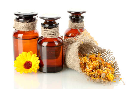 medicine bottles and calendula, isolated on white photo