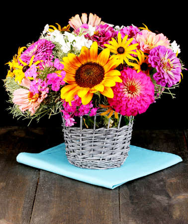 ronantic: Beautiful bouquet of bright flowers on  wooden table on black background