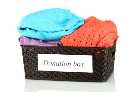 Donation box with clothing isolated on white photo