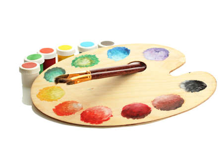 wooden art palette with paint and brushes isolated on white Stock Photo - 15198021