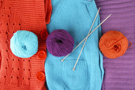 colorful wool sweaters and balls of wool close-up Stock Photo - 15198879