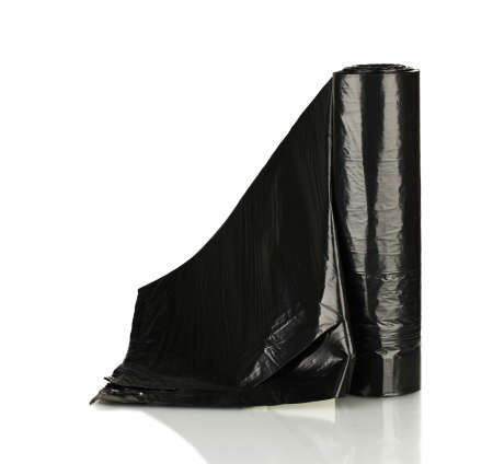 plastic garbage bag on grey background close-up photo