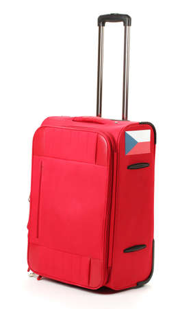 red suitcase with sticker with flag of Czech Republic isolated on white photo
