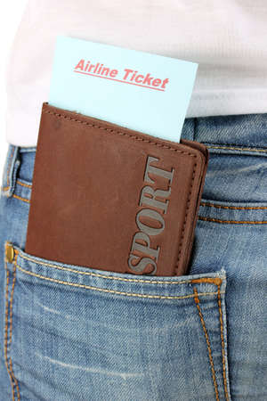 Passport and ticket in jeans pocket close-up photo