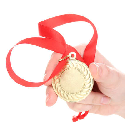 Gold medal in hand isolated on white Stock Photo - 15197630