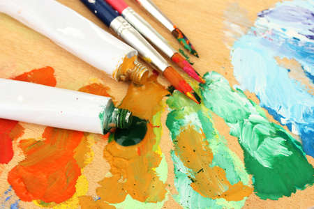 Abstract acrylic paint, paint tubes and brushes on wooden  palette Stock Photo - 15184600
