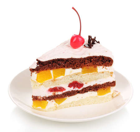 cake decorating: Layered fruit cake isolated on white