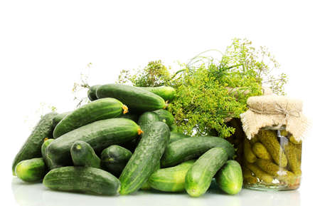 cuke: fresh cucumbers, pickles and dill  isolated on white