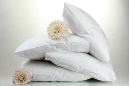 pillows and flowers, on grey background photo