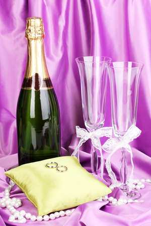 Wedding accessories on purple cloth background photo