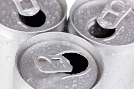 aluminum cans with water drops close-up photo