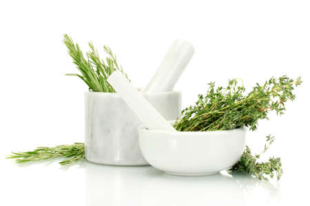 mortars with fresh green thyme and rosemary isolated on white photo